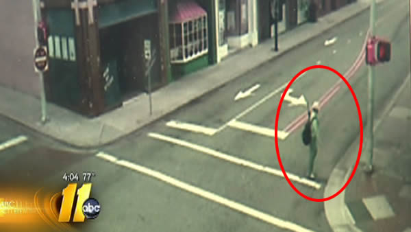 Student with umbrella spotted near down town Greenville - sparks panic