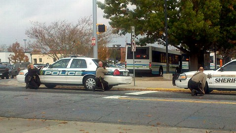 Greenville police surround a bus after internet rumors that a gunman had taken hostages on public transport